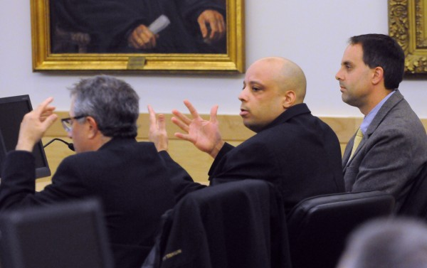 Randall Daluz reacts as the verdict is read at the Penobscot Judicial Center in Bangor Wednesday. The jury found Daluz guilty on three counts of murder and one count of arson. Also pictured are Daluz's attorneys Jeffrey Silverstein (left) and Hunter Tzovarras.