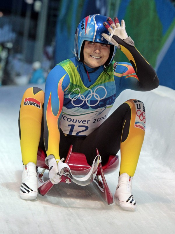 Julia Clukey of the United States waves at the finish after her first run of the women's singles luge competition at the Vancouver 2010 Olympics in Whistler, British Columbia, Monday, Feb. 15, 2010.