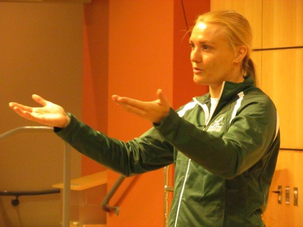 Augusta native and member of the 2010 U.S. Olympic luge team Julia Clukey speaks before an auditorium of Biddeford High School seniors Tuesday, April 29.