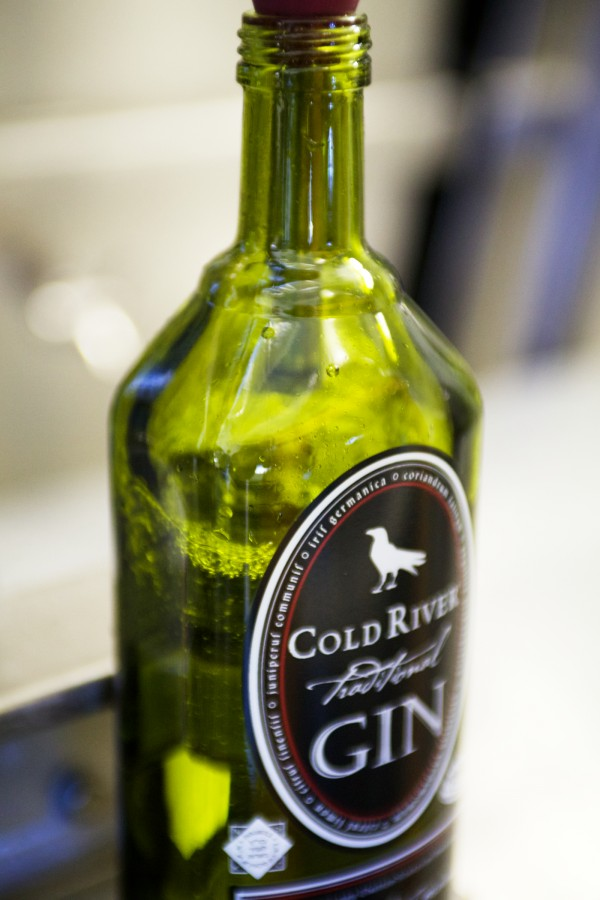 Cold River Gin flows into a bottle at Maine Distilleries on Route 1 in Freeport recently. Both the gin and Cold River Vodka are made from Maine potatoes.