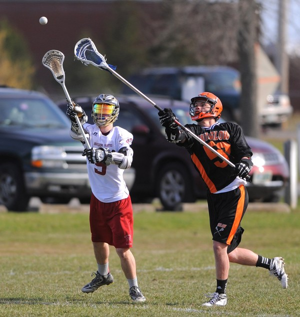 Bangor's Griffin Marshall (left) and Winslow's Connor Wildes reach for a long pass intended for Marshall during a club lacrosse game in Bangor Tuesday.