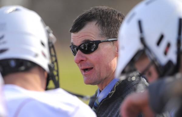 Bangor club lacrosse coach Dave Barnett talks to his team during a game against Winslow Tuesday.