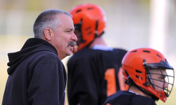 Winslow club lacrosse coach Bruce Lambrecht watches his team compete against Bangor Tuesday.