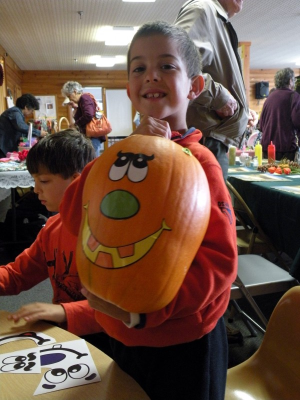Just one of the proud pumpkin decorators at last year's Rangeley Lakes Region Logging Museum's Apple Harvest Festival.