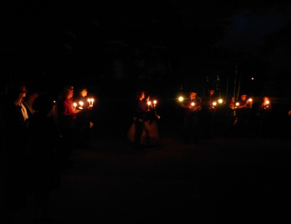 Members attending the candlelight event at Mt Hope Cemetery included descendants of men of the 1st Maine Heavies