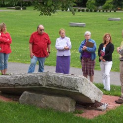 Students learn about a Holocaust Memorial on the campus of UMA as part of the HHRC's Summer Seminar.