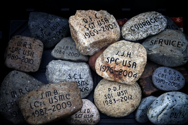 Summit Project stones, inscribed with the name of a Maine service member killed since 2001, wait to be distributed among motorcyclists and carried north to Mount Katahdin Friday.
