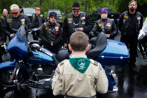 Boy Scout Dominic Borrelli tells Patriot Guard motorcyclists about the stone they are about to carry north Friday in Portland. Each stone from the Summit Project is inscribed with the name of a Maine service member killed since 2001.