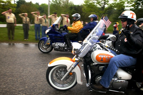 Local Scouts salute Patriot Guard Riders as they rumble out of the Elks Lodge parking lot on outer Congress Street in Portland Friday morning in the drizzling rain. Each motorcycle carried a memorial stone, in honor of a fallen Maine service member, bound for Mount Katahdin.