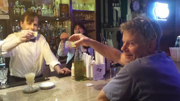 Tree Spirits owner Bruce Olson toasting with Paul and Connie, owners of the Big Easy in Bangor