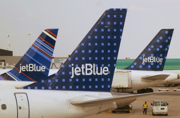 JetBlue Airways aircraft are pictured at departure gates at John F. Kennedy International Airport in New York in this June 2013 file photo.