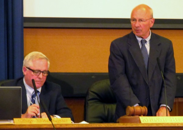 Portland Mayor Michael Brennan presides over a meeting of the City Council Monday night alongside City Manager Mark Rees. The council considered a ban of polystyrene containers and fees on single-use paper and plastic bags at the meeting.