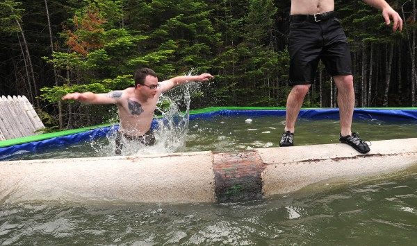 Justin James (left) falls into the water while practicing a log roll with Ethan Klein in preparation for the season opening at The Great Maine Lumberjack Show in Trenton. They are among the lumberjacks who will appear in &quotTimber&quot Tina Scheer's show this summer, a unique, old-fashioned show combining old and new kinds of lumberman skills. Like many of the participants, James has no experience in the events, however Klein is a nine-year veteran of the show and is able to offer pointers.