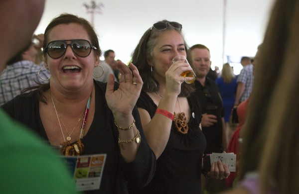 Julie Stacey (left) and Tracy Vassiliev enjoy beer and friends during Bangor's second Tap into Summer Beer Festival on the waterfront in Bangor.
