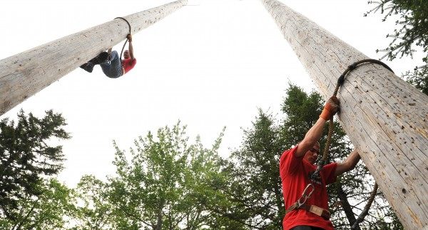 Lumberjacks Eric Goode (left) and Jack Weeks practice speed climbing at The Great Maine Lumberjack Show in Trenton.  The participants of &quotTimber&quot Tina Scheer's show agree that climbing up the approximately 50-foot-tall poles can be unnerving.