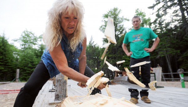 Wood chips fly as &quotTimber&quot Tina Scheer (left) shows Sam Smith how to prepare a log for the underhand chop during practice for The Great Maine Lumberjack Show in Trenton. &quotTimber&quot Tina Scheer said that for the first time in the show's 19-year history there are no lumberjills on the crew of the Trenton-based venue. She started participating in lumberjack shows about 35 years ago in Wisconsin in venues that were started by her family.