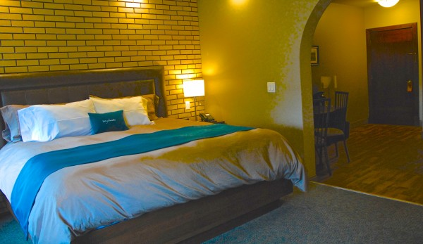 Original brick walls are incorporated in the guest rooms at Inn of Acadia.
