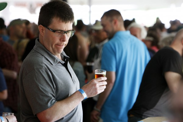 John Kingsbury enjoys a beer during Bangor's second Tap into Summer Beer Festival on the waterfront in Bangor.