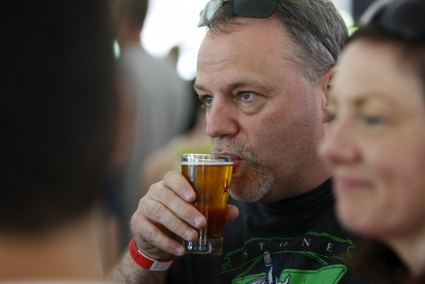 Gerald Kelly enjoys a beer during Bangor's second Tap into Summer Beer Festival on the waterfront in Bangor.