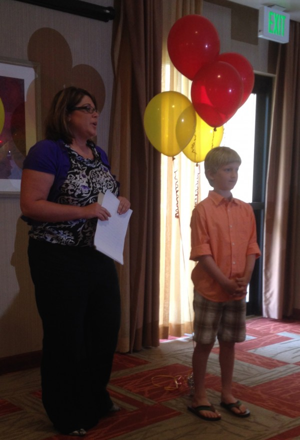 Noah Tibbetts, Children's Miracle Network 2014 State of Maine Champion Child, stands beside Kelly Pearson, Director of EMHS Foundation Children's Miracle Network Hospitals, at his special ceremony.