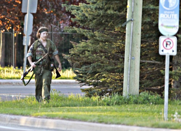 A heavily armed man that police have identified as Justin Bourque walks on Hildegard Drive in Moncton, New Brunswick on Wednesday after several shots were fired in the area.