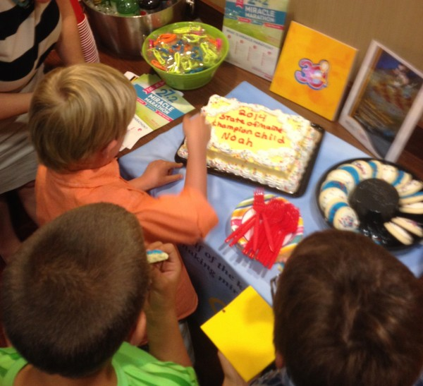 Noah Tibbetts, Children's Miracle Network 2014 State of Maine Champion Child, enjoys a well-deserved piece of cake.