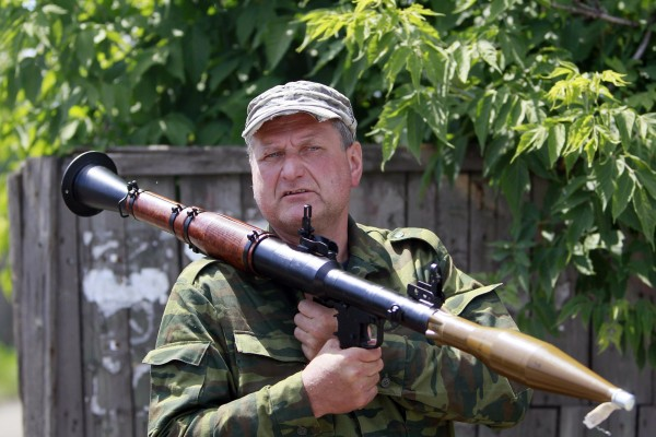 An armed pro-Russian separatist stands guard in Seversk (Siversk), located near the town of Krasny Liman, Donetsk region, June 19, 2014. Ukrainian troops and pro-Russian separatists were locked in fierce fighting in the east of Ukraine on Thursday after rebels rejected a call to lay down their arms in line with a peace plan proposed by President Petro Poroshenko, government forces said.
