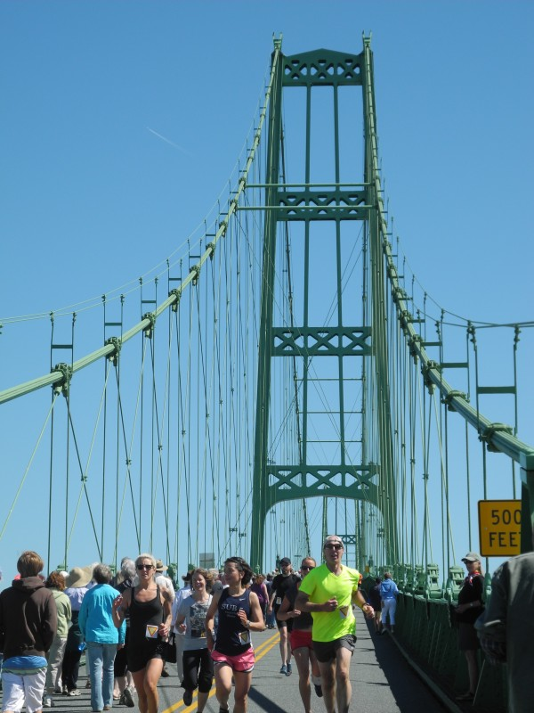 Traffic on the Deer Isle-Sedgwick Bridge stopped for an hour Saturday so a crowd of about 1,000 walkers, runners and others could mark the structure's 75th anniversary. &quotWe've been over this bridge I don't know how many hundreds of times, but we've never walked it, so this is cool,&quot said Melissa Walton of Brewer, whose family is from Deer Isle.