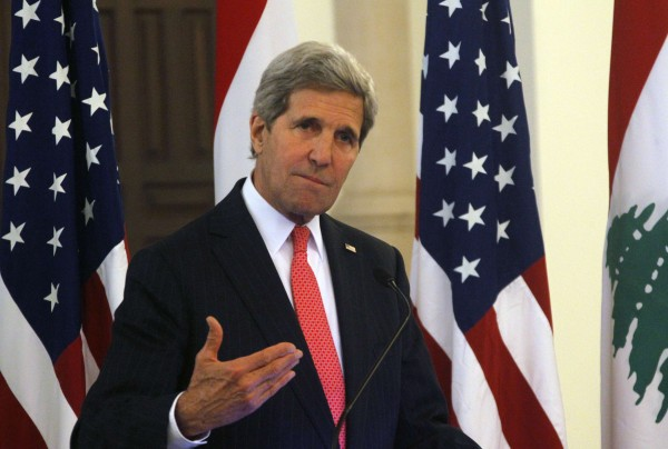 Secretary of State John Kerry gestures as he speaks during a news conference after meeting with Lebanon's Prime Minister Tammam Salam at the government palace in Beirut June 4, 2014.