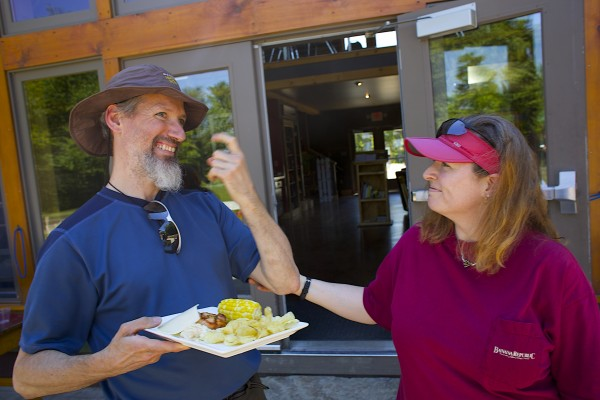 Roger Poulin (left), a deaf and blind man from Washington, and his service provider Roni Lepore, who also is deaf, celebrate on Friday at the River Drivers Restaurant on Millinocket Lake. The two finished hiking the Appalachian Trail together on Tuesday.