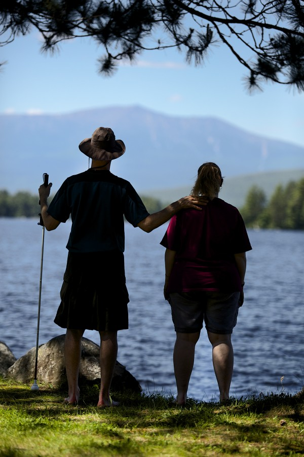 Roger Poulin (left), a deaf and blind man from Washington, and his service provider Roni Lepore of New Jersey, who is also deaf, pose for a picture Friday in Millincoket. The two finished hiking the Appalachian Trail together on Tuesday at the top of Mount Katahdin in Baxter State Park.