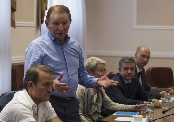 Former Ukrainian President Leonid Kuchma speaks next to OSCE Ambassador Heidi Tagliavini (3rd R) and Russian Ambassador to Ukraine Mikhail Zurabov (2nd R) during a meeting with leaders of the self-proclaimed Donetsk People's Republic and Luhansk People's Republic in the city of Donetsk June 23, 2014.