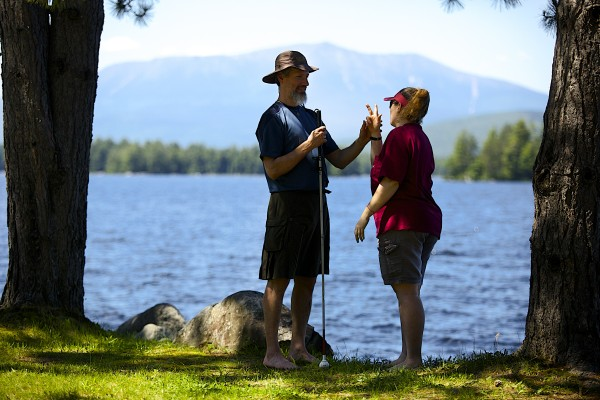 Roger Poulin (left), a deaf and blind man from Washington, and his service provider Roni Lepore, who also is deaf, on Friday in Millinocket. The two finished hiking the Appalachian Trail together on Tuesday at the top of Mount Katahdin in Baxter State Park.