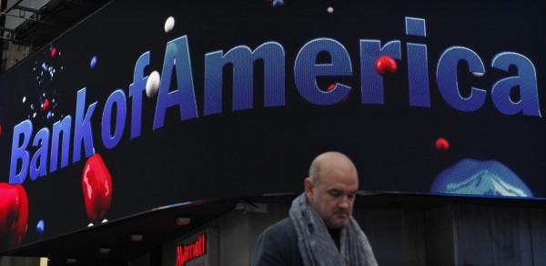 A man walks next to a Bank of America branch in New York in this file photo taken October 24, 2012.