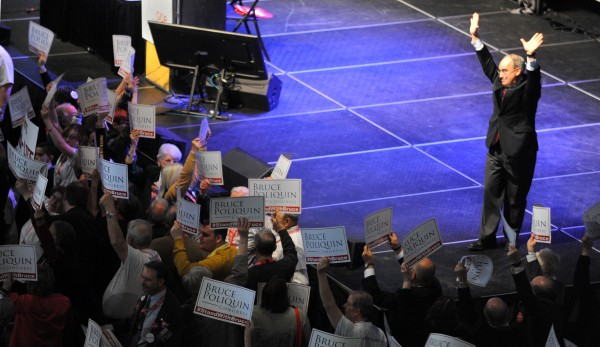 Former state treasurer Bruce Poliquin of Oakland waves to supporters after a campaign speech on the second day of the 2014 Maine Republican Convention at the Cross Insurance Center in Bangor Saturday.