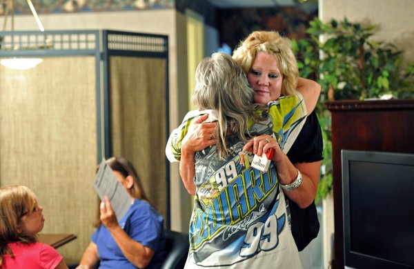 Melinda Elkins Dawson (right) of Canton, Ohio, who is one of Hicks Babies and organizer, gets a hug from Connie Sayers, of Copperhill, Tenn., who is a possible relative of Hicks baby, after Sayers had her DNA swab sampling done at Ocoee River Inn in Ducktown, Tennessee, on June 21.