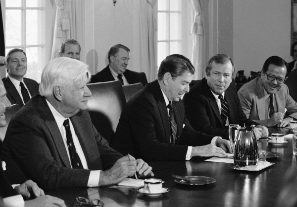 In this Jan. 25, 1984 file photo, President Ronald Reagan is flanked by Congressional leaders during a meeting in the Cabinet Room of the White House in Washington. From left are, House Speaker Thomas P. O'Neill; Chief of Staff James Baker, partly obscured; Attorney General Nominee Edwin Meese; President Reagan; Majority Leader Howard Baker; and Majority Whip Ted Stevens of Alaska.
