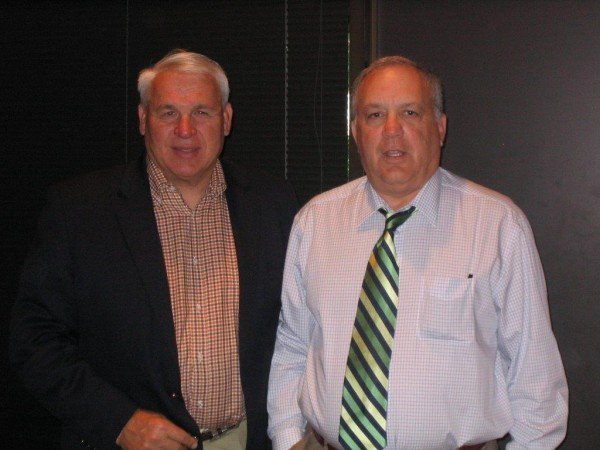 Former University of Maine football star John Huard (left), who owns Northeast Turf/Eastern Builders in South Portland, started a career in the turf business after meeting the late John Gilman, the former CEO of the FieldTurf company.