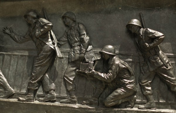 A portion of a relief depicting World War Two U.S. military troops and a war photographer is seen at the National World War II Memorial in Washington June 5, 2014.