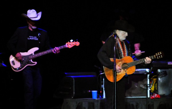 Willie Nelson (center) plays his guitar Thursday at Darling's Waterfront Pavilion in Bangor.