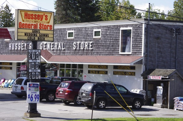 At Hussey's General Store in Windsor, the sign out front advertises &quotGuns, wedding gowns, cold beer.&quot