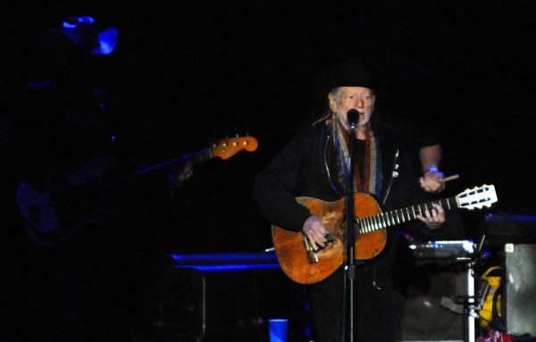 Willie Nelson plays his guitar during the Willie Nelson, Alison Krauss and Kacey Musgraves concert Thursday at Darling's Waterfront Pavilion in Bangor.