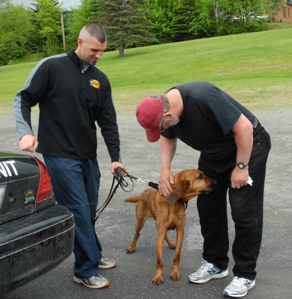 St. Francis residents rushed to congratulate the man and dog who brought an end to the six-day manhunt.