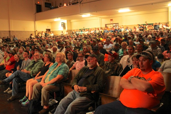 Festivalgoers crowd into the Greenville High School auditorium to hear the drawing of the 2013 Moose Lottery on June 15, 2013, in Greenville, during which 4,110 people's names were announced as 2013 moose hunting permit winners in Maine.