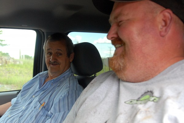 Jim Stanley Sr. (from left) and his son, Jim Jr., were among the 20 or so bidders Jim Stanley Jr. counted at an auction at the Millinocket mill site on Thursday, June 19, 2014.