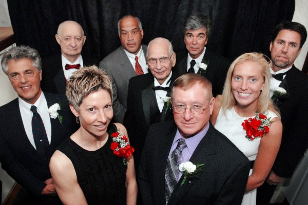 2009 Maine Sports Hall of Fame inductees include (front, left to right) Cindy Blodgett and Sam Pendleton, (second row, left to right) Ken Perrone, George Hale, and Rachel Reilly (representing her grandfather, the late Jack Butterfield), and (back row, left to right) Bob Kelley, Pete McCarty, Jon MacDonald and Dick Scott.