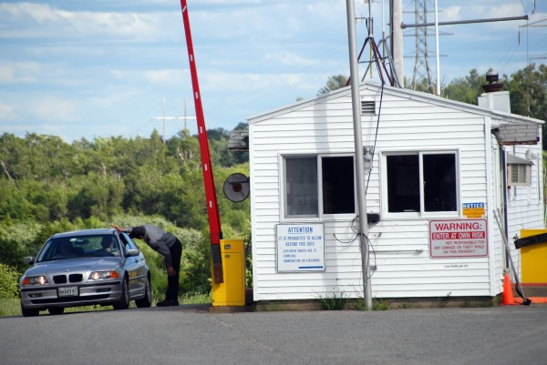 Vehicles leave the Katahdin Avenue industrial park in Millinocket after an auction of papermaking equipment on Thursday, July 19, 2014.