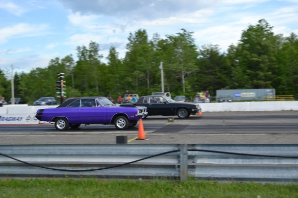 Two street car drivers race at the Winterport Dragway's Street Nights event on Saturday.