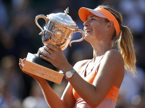 Maria Sharapova of Russia holds the French Open trophy  Saturday after defeating Simona Halep of Romania in the women's singles final at Roland Garros in Paris.
