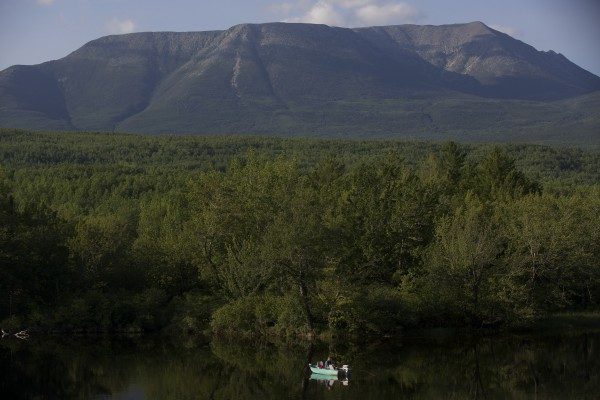 A fisherman casts into the West Branch of the Penobscot with Mount Katahdin in the background in this July 8, 2013 photo.
